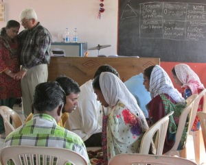 Couples praying together in Vyara